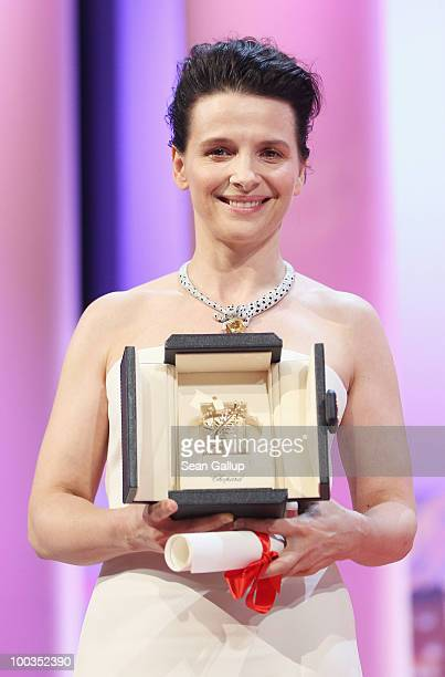 Actress Juliette Binoche poses after winning the Best Actress award for her role in 'Certified Copy' during the Palme d'Or Award Ceremony held at the...