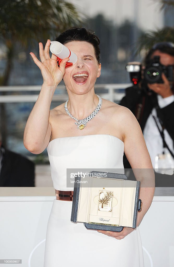 Actress Juliette Binoche poses with her Best Actress award for her role in 'Certified Copy' (Copie Conforme) at the Palme d'Or Award Ceremony photocall held at the Palais des Festivals during the 63rd Annual Cannes Film Festival on May 23, 2010 in Cannes, France.