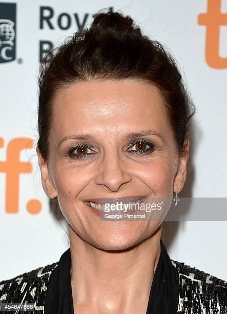 Actress Juliette Binoche signs autographs as she attends the 'Clouds Of Sils Maria' premiere during the 2014 Toronto International Film Festival at...