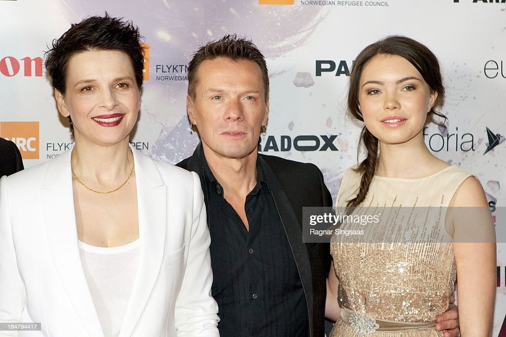 Actress Juliette Binoche, U2 drummer Larry Mullen Jr and actress Lauryn Canny attend the Oslo premiere of 'A Thousand Times Good Night' at Colosseum on October 16, 2013 in Oslo, Norway.
