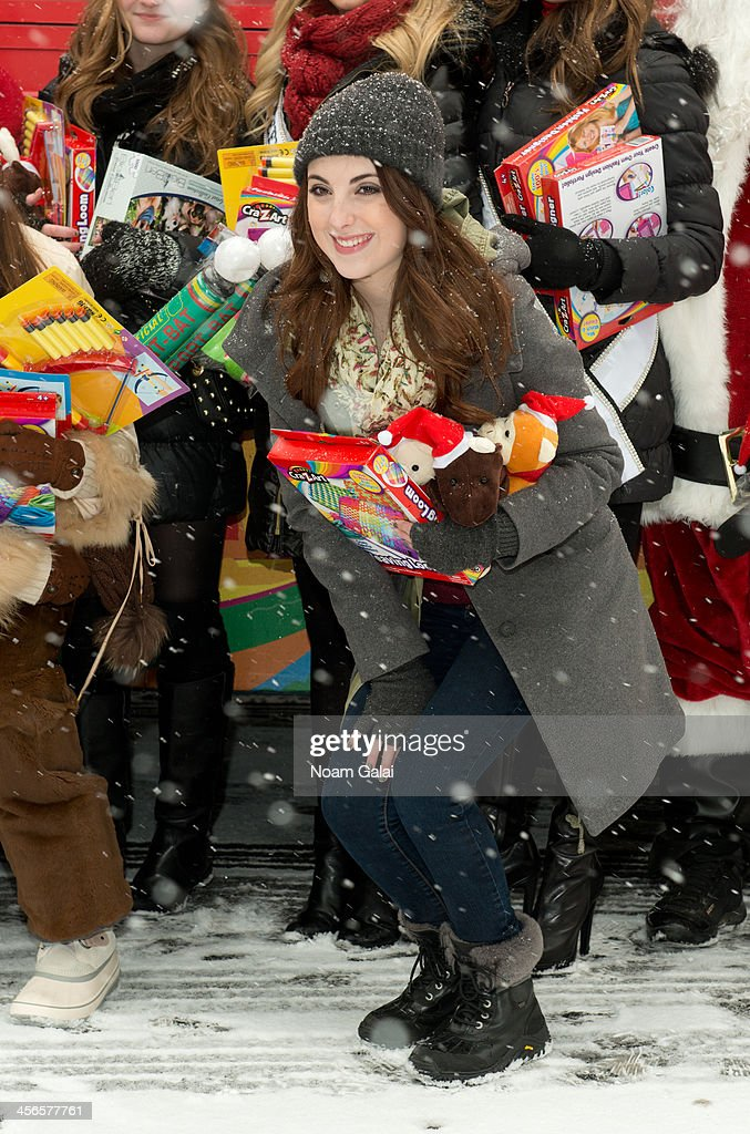 Actress Juliette Goglia attends the 2013 CitySightseeing New York holiday toy drive at PAL's Harlem Center on December 14, 2013 in New York City.