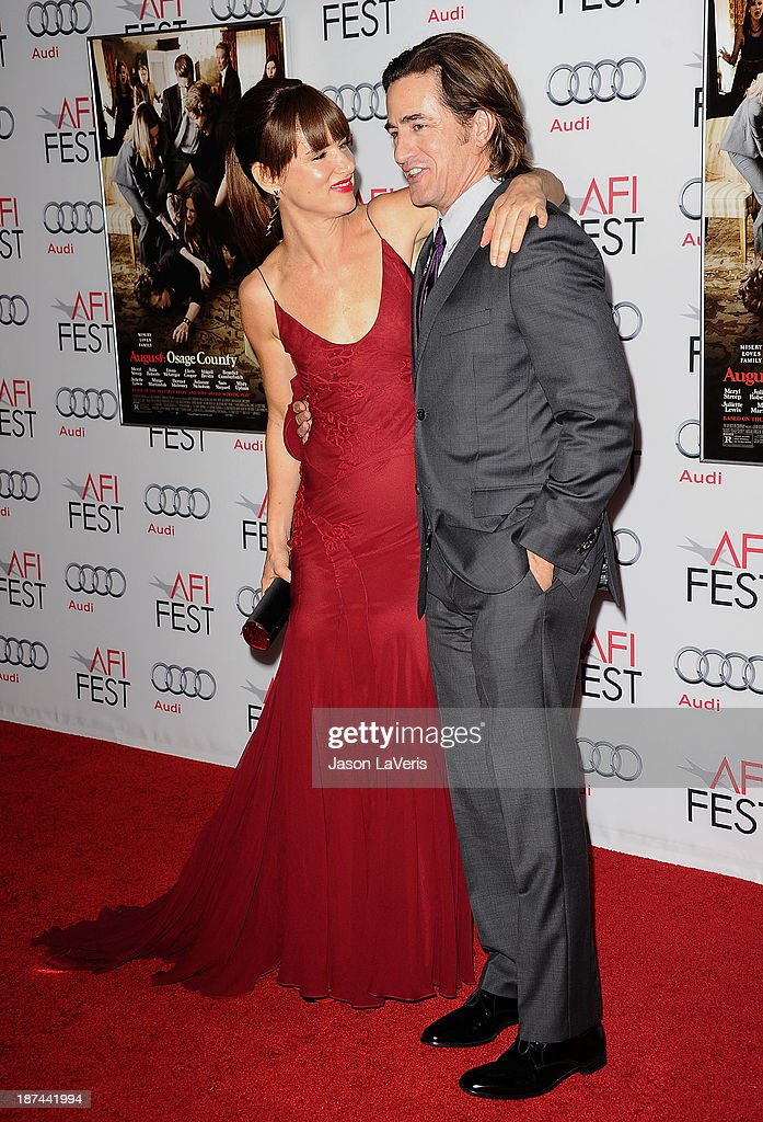Actress Juliette Lewis and actor Dermot Mulroney attend the premiere of 'August: Osage County' at the 2013 AFI Fest at TCL Chinese Theatre on November 8, 2013 in Hollywood, California.