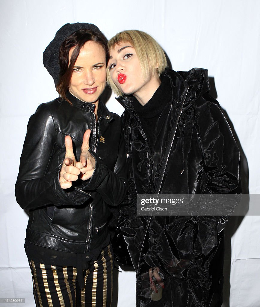 Actress Juliette Lewis (L) and Singer Miley Cyrus pose backstage during The 24th Annual KROQ Almost Acoustic Christmas at The Shrine Auditorium on December 7, 2013 in Los Angeles, California.