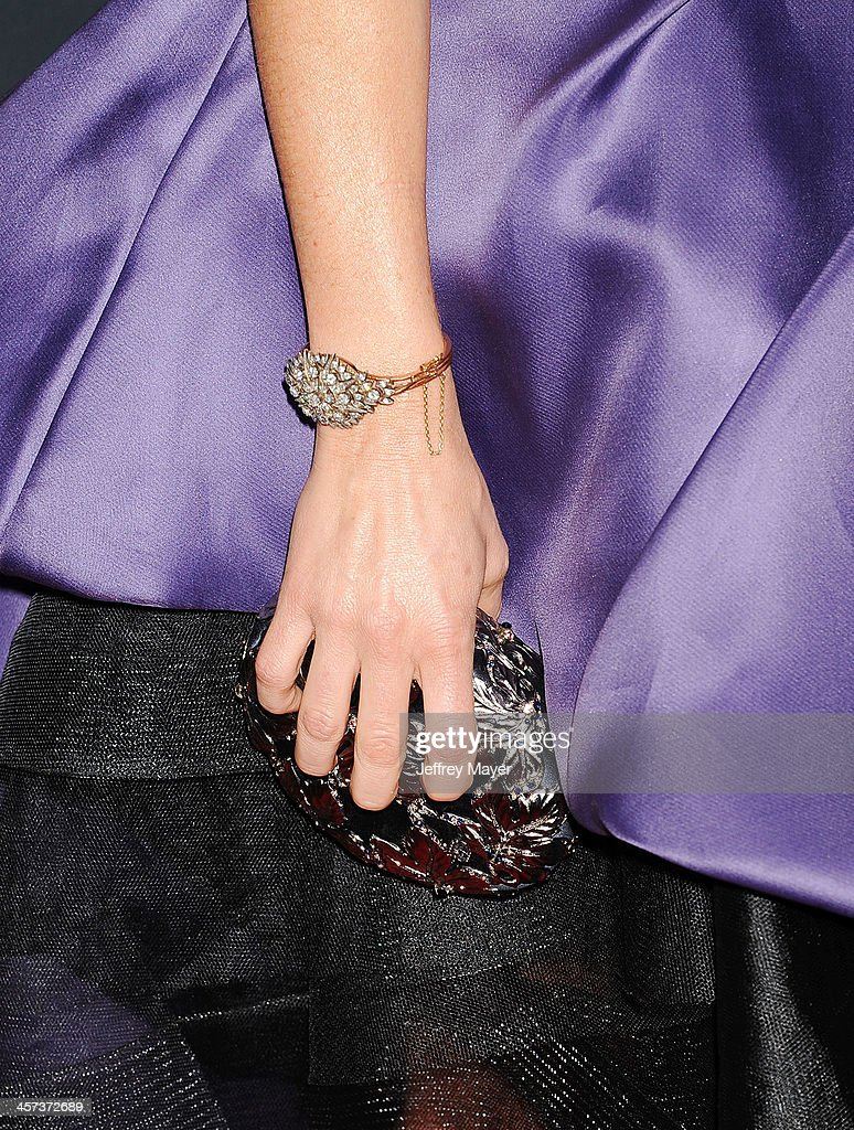 Actress Juliette Lewis (handbag, bracelet detail) at the 'August: Osage County' - Los Angeles Premiere at Regal Cinemas L.A. Live on December 16, 2013 in Los Angeles, California.
