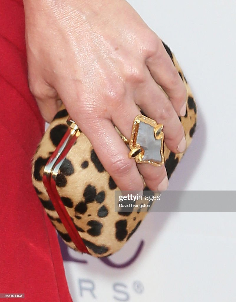 Actress Juliette Lewis (purse & ring detail) attends the 19th Annual Critics' Choice Movie Awards at Barker Hangar on January 16, 2014 in Santa Monica, California.