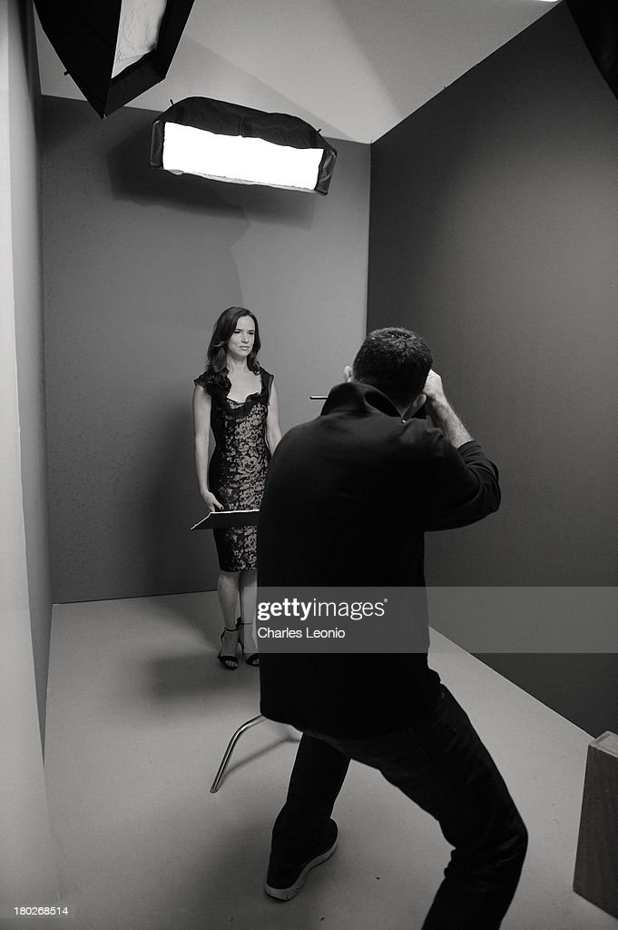 Actress Juliette Lewis poses for a portrait with photographer Larry Busacca during the 2013 Toronto International Film Festival on September 10, 2013 in Toronto, Canada.