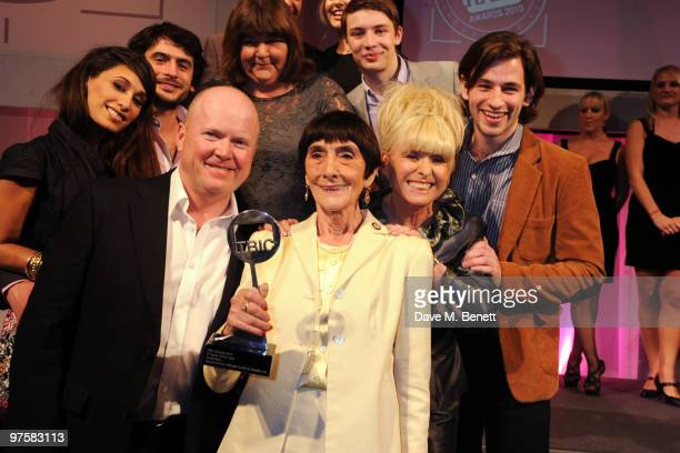 Actress June Brown poses with her award and fellow Eastenders cast members at the 2010 TRIC Awards at the Grovesnor House Hotel March 09 2010 in...