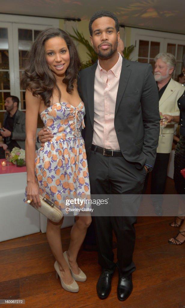 "Actress <a gi-track='captionPersonalityLinkClicked' href=/galleries/search?phrase=Jurnee+Smollett&family=editorial&specificpeople=614220 ng-click='$event.stopPropagation()'>Jurnee Smollett</a> (L) wearing Juicy Couture and husband musician Josiah Bell attend Vanity Fair and Juicy Couture's Celebration of the 2013 ""Vanities"" Calendar hosted by Vanity Fair West Coast Editor Krista Smith and actress Olivia Munn in support of the Regional Food Bank of Oklahoma, a member of Feeding America, at the Chateau Marmont on February 18, 2013 in Los Angeles, California."