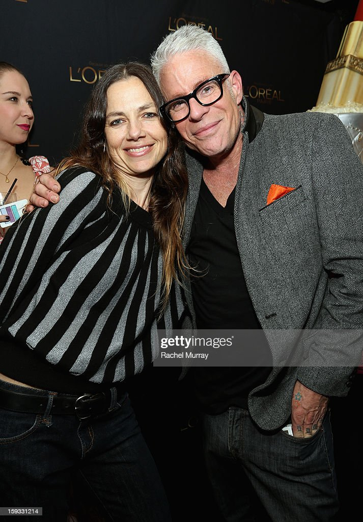 Actress <a gi-track='captionPersonalityLinkClicked' href=/galleries/search?phrase=Justine+Bateman&family=editorial&specificpeople=240325 ng-click='$event.stopPropagation()'>Justine Bateman</a> (L) stands with L'Oreal Paris Consulting Make-up Artist Billy B. (R) at the L'Oreal cocktail party at Four Seasons Hotel Los Angeles at Beverly Hills on January 11, 2013 in Beverly Hills, California.