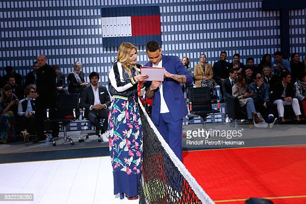 Actress Justine Fraioli and Football players Gregory van der Wiel do the show during Tommy Hilfiger hosts Tommy X Nadal Party Tennis Soccer match on...