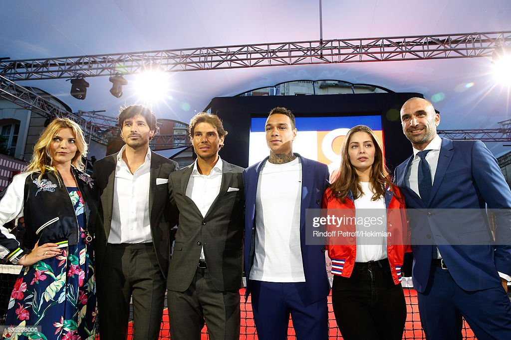 Actress Justine Fraioli, Model Andres Velencoso Segura, Tennis player Rafael Nadal, Football player Gregory van der Wiel, Model Marie-Ange Casta and Football player Jerome Alonzo attend Tommy Hilfiger hosts Tommy X Nadal Party - Photocall on May 18, 2016 in Paris, .