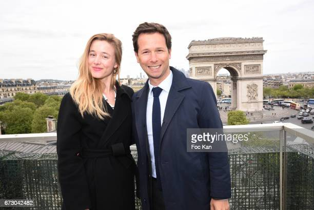 Actress Justine Thibaudat and Harold Parisot founder of Chinese Business Club attend 'Semaine du Cinema Positif' Cocktail at Terrasse du Publicis...