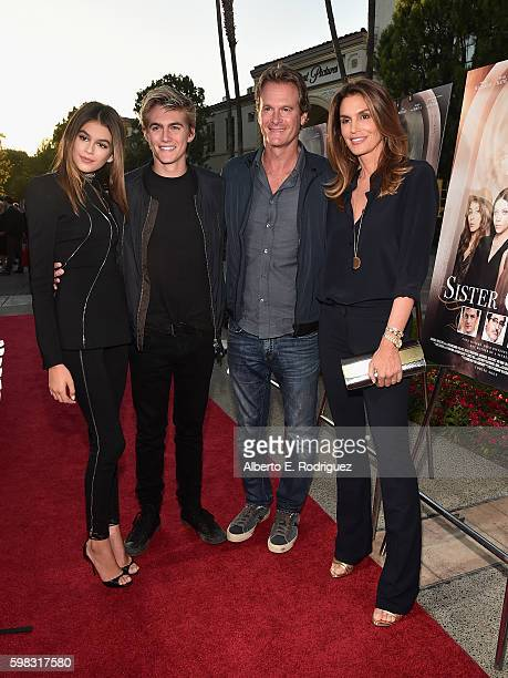 Actress Kaia Gerber Presley Gerber Rande Gerber and model Cindy Crawford attend the premiere of Lifetime's 'Sister Cities' at Paramount Theatre on...
