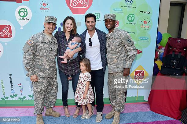 Actress Kaitlin Riley and actor Jordi Vilasuso pose with members of the US Army National Guard at the Step2 Favoredby Present The 5th Annual Red...