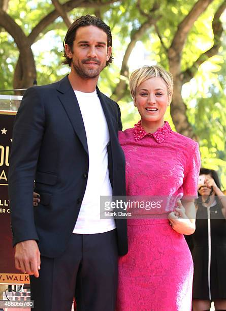 Actress Kaley Cuoco and husband Ryan Sweeting pose with her star on the Hollywood Walk of Fame on October 29 2014 in Hollywood California