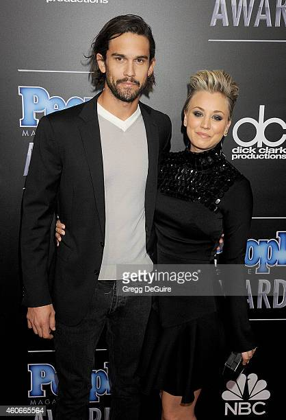 Actress Kaley Cuoco and Ryan Sweeting arrive at The PEOPLE Magazine Awards at The Beverly Hilton Hotel on December 18 2014 in Beverly Hills California