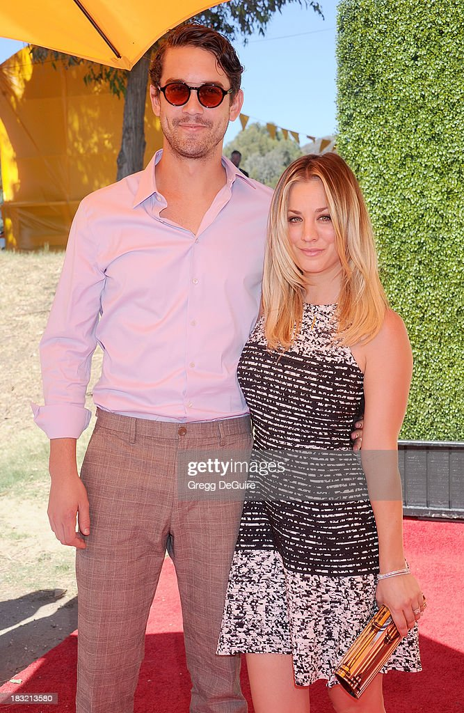 Actress Kaley Cuoco and tennis player Ryan Sweeting arrive at the Veuve Clicquot Polo Classic at Will Rogers State Historic Park on October 5, 2013 in Pacific Palisades, California.