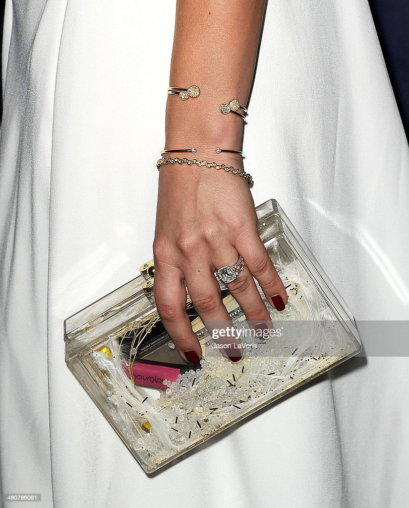 Actress Kaley Cuoco (handbag and jewelry detail) attends the 22nd 'A Night At Sardi's' at The Beverly Hilton Hotel on March 26, 2014 in Beverly Hills, California.