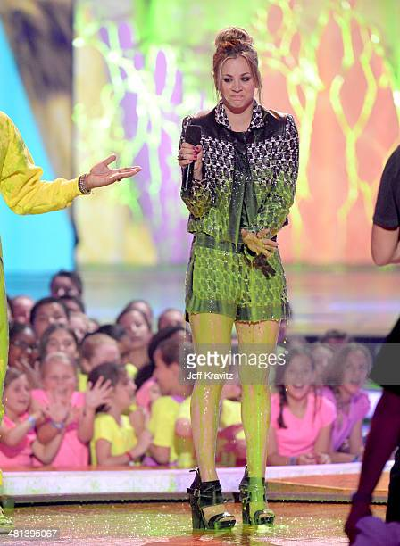 Actress Kaley Cuoco gets slimed onstage at Nickelodeon's 27th Annual Kids' Choice Awards at USC Galen Center on March 29 2014 in Los Angeles...