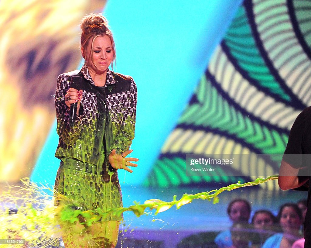 Actress Kaley Cuoco gets slimed onstage during Nickelodeon's 27th Annual Kids' Choice Awards held at USC Galen Center on March 29, 2014 in Los Angeles, California.