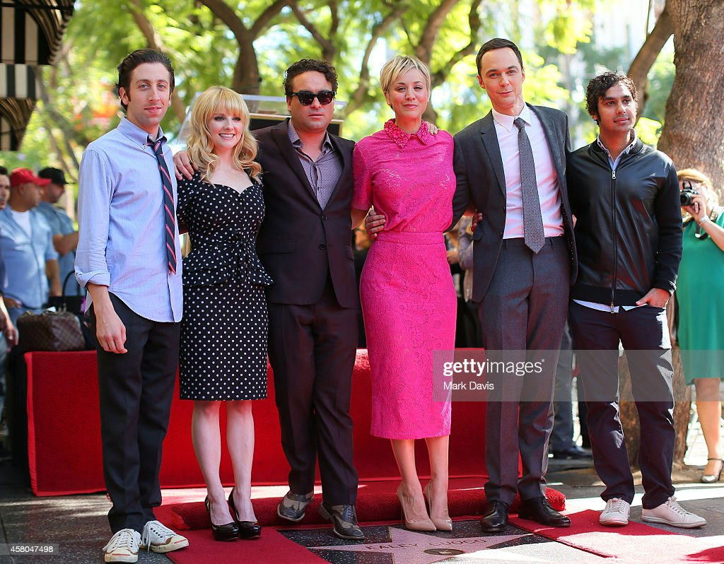Actress Kaley Cuoco poses with the cast of the Big Bang Theory at the Hollywood Walk of Fame October 29 2014 in Hollywood California