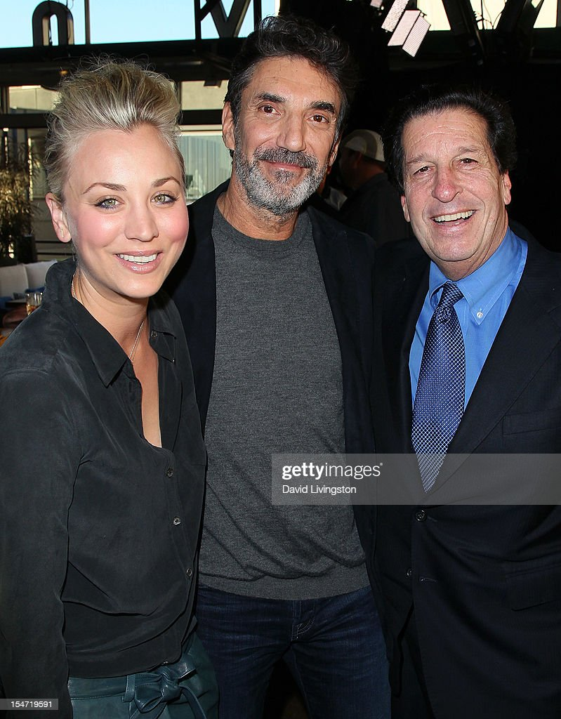 Actress Kaley Cuoco, writer Chuck Lorre and Warner Bros. Television president Peter Roth attend a reception to celebrate the release of Lorre's 'What Doesn't Kill Us Makes Us Bitter' at Mixology101 & Planet Dailies on October 24, 2012 in Los Angeles, California.