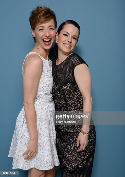 Actress Karine Vanasse and actress Emily Hampshire of 'All The Wrong Reasons' pose at the Guess Portrait Studio during 2013 Toronto International...
