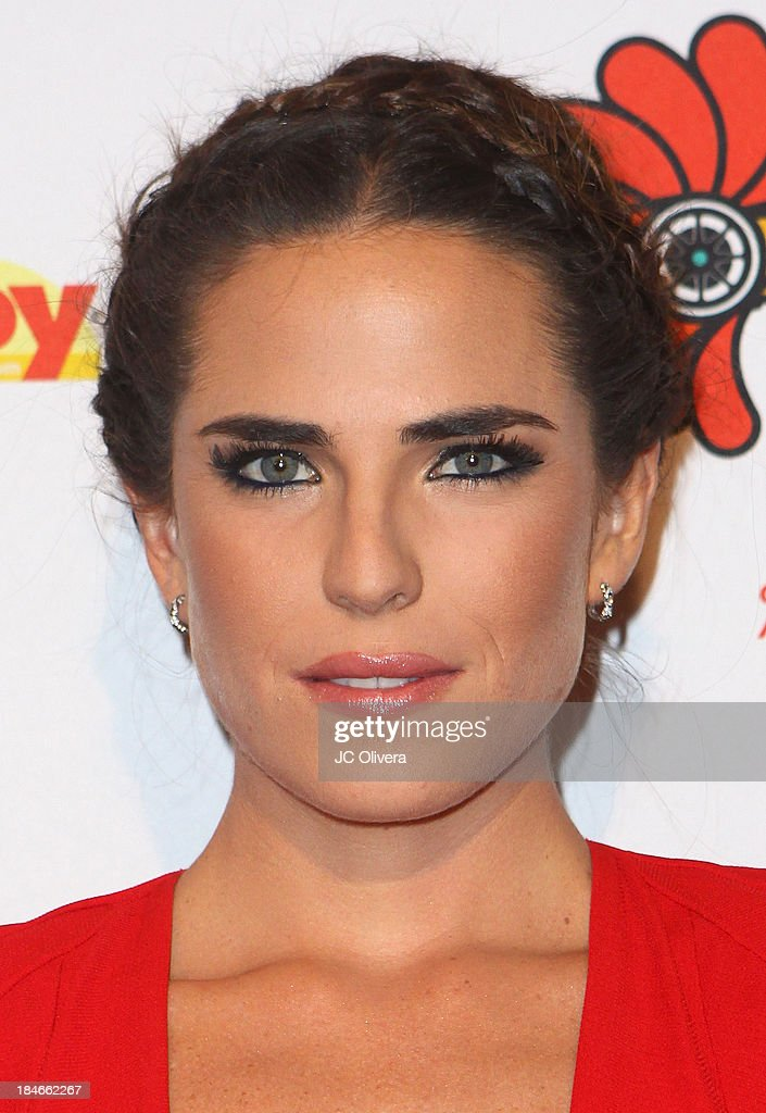 Actress <a gi-track='captionPersonalityLinkClicked' href=/galleries/search?phrase=Karla+Souza&family=editorial&specificpeople=6147755 ng-click='$event.stopPropagation()'>Karla Souza</a> attends The 2013 Los Angeles Latino International Film Festival - Closing Night Premiere of 'Nosotros Los Nobles' at The Orpheum Theatre on October 14, 2013 in Los Angeles, California.