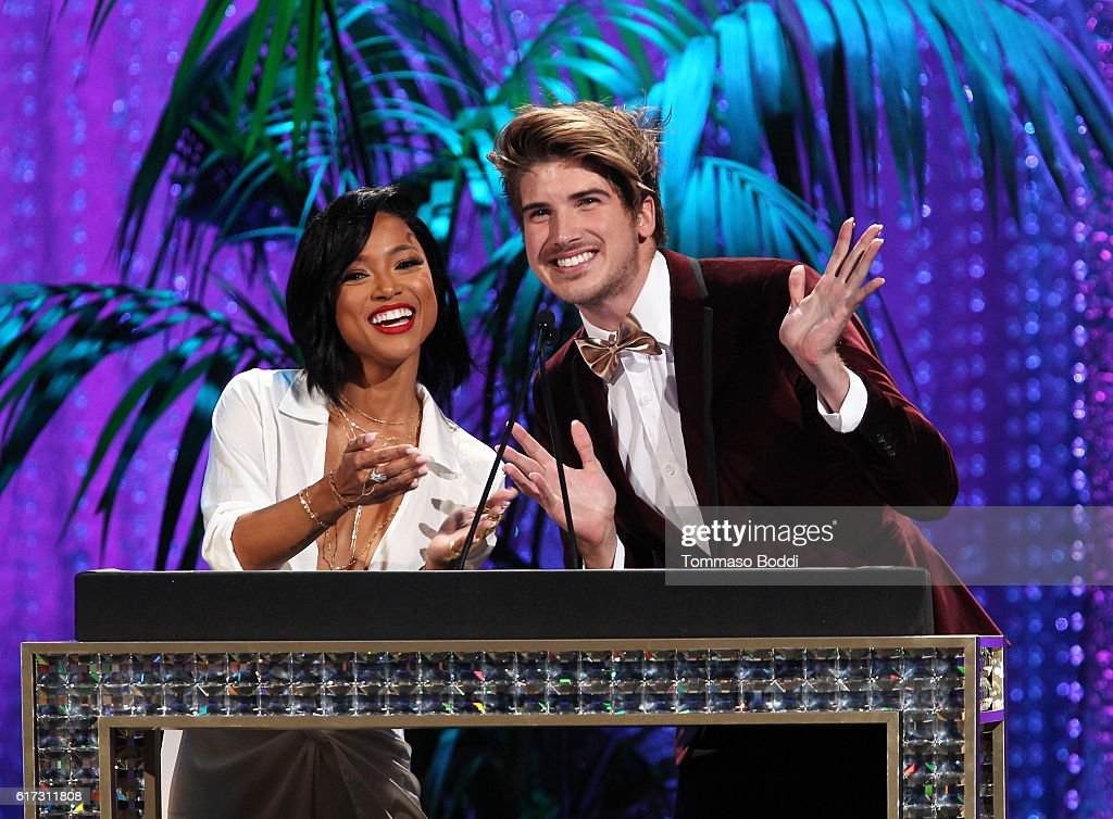 Actress Karrueche Tran (L) and internet personality Joey Graceffa speak onstage during the Environmental Media Association 26th Annual EMA Awards Presented By Toyota, Lexus And Calvert at Warner Bros. Studios on October 22, 2016 in Burbank, California.