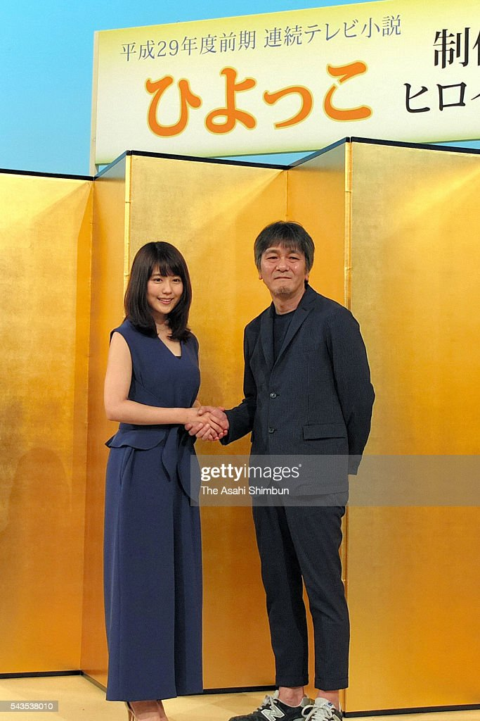 Actress <a gi-track='captionPersonalityLinkClicked' href=/galleries/search?phrase=Kasumi+Arimura&family=editorial&specificpeople=13690573 ng-click='$event.stopPropagation()'>Kasumi Arimura</a> (L) and screenwriter Yoshikazu Okada (R) shake hands during the NHK's new morning television drama series 'Hiyokko' press conference on June 29, 2016 in Tokyo, Japan.