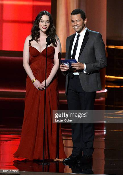 Actress Kat Dennings and actor Jon Cryer speak onstage at the 64th Primetime Emmy Awards at Nokia Theatre LA Live on September 23 2012 in Los Angeles...