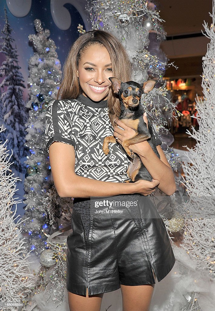 Actress Kat Graham and her dog Izzy attends The Kick Off 'Holiday Pet Portraits With Santa!' at The Beverly Center on November 14, 2013 in Los Angeles, California.