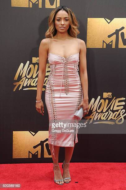 Actress Kat Graham arrives at the 2016 MTV Movie Awards at Warner Bros Studios on April 9 2016 in Burbank California