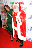 Actress Kat Graham poses with Santa Claus at the 84th Annual Hollywood Christmas Parade held at The Roosevelt Hotel on November 29 2015 in Hollywood...
