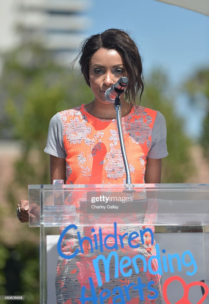 Actress Kat Graham speaks onstage during the Children Mending Hearts 6th Annual Fundraiser 'Empathy Rocks: A Spring Into Summer Bash' at a private residence on June 14, 2014 in Beverly Hills, California.