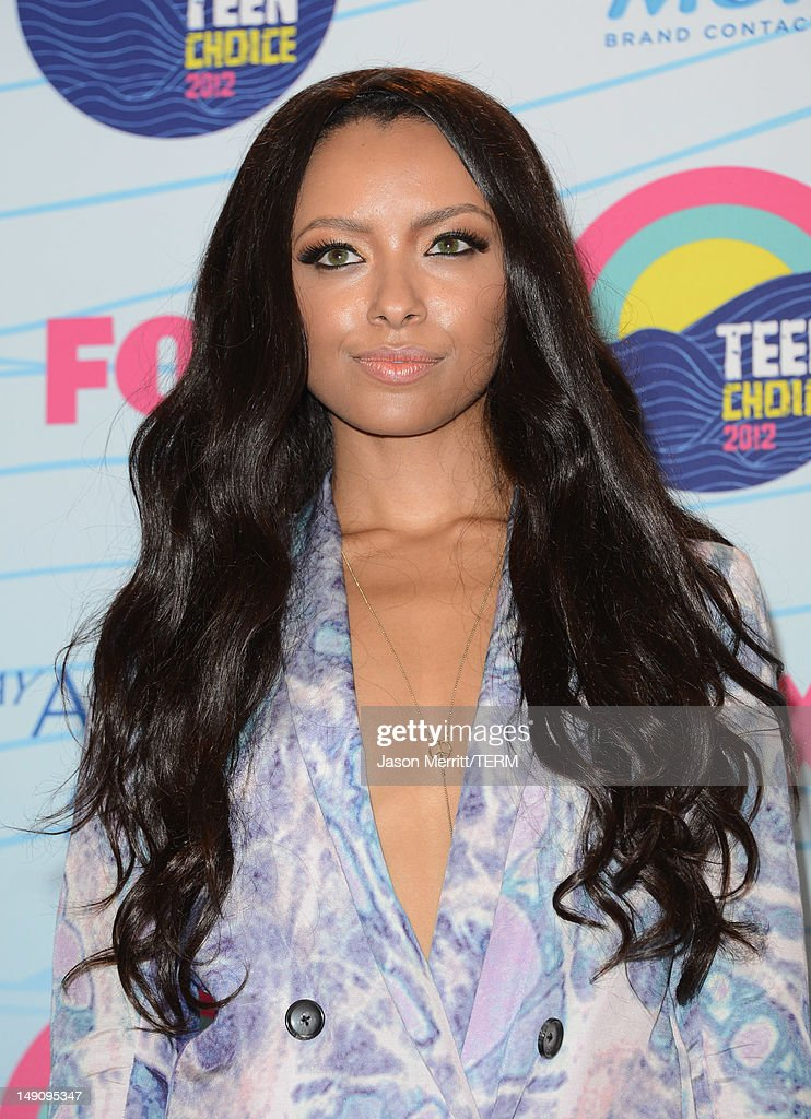 Actress Kat Graham, winner of Choice Fantasy/Sci-Fi Show award, poses in the press room during the 2012 Teen Choice Awards at Gibson Amphitheatre on July 22, 2012 in Universal City, California.