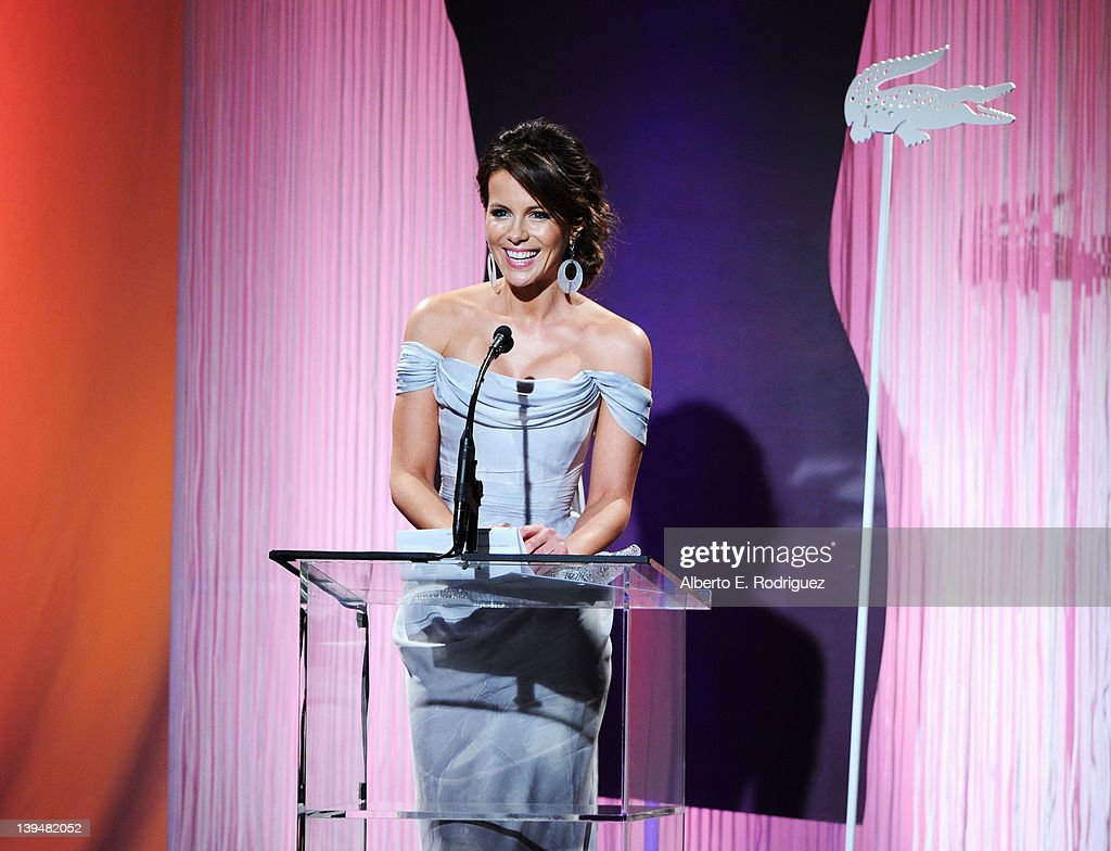 Actress <a gi-track='captionPersonalityLinkClicked' href=/galleries/search?phrase=Kate+Beckinsale&family=editorial&specificpeople=202911 ng-click='$event.stopPropagation()'>Kate Beckinsale</a> accepts the Lacoste Spotlight Award onstage during the 14th Annual Costume Designers Guild Awards With Presenting Sponsor Lacoste held at The Beverly Hilton hotel on February 21, 2012 in Beverly Hills, California.