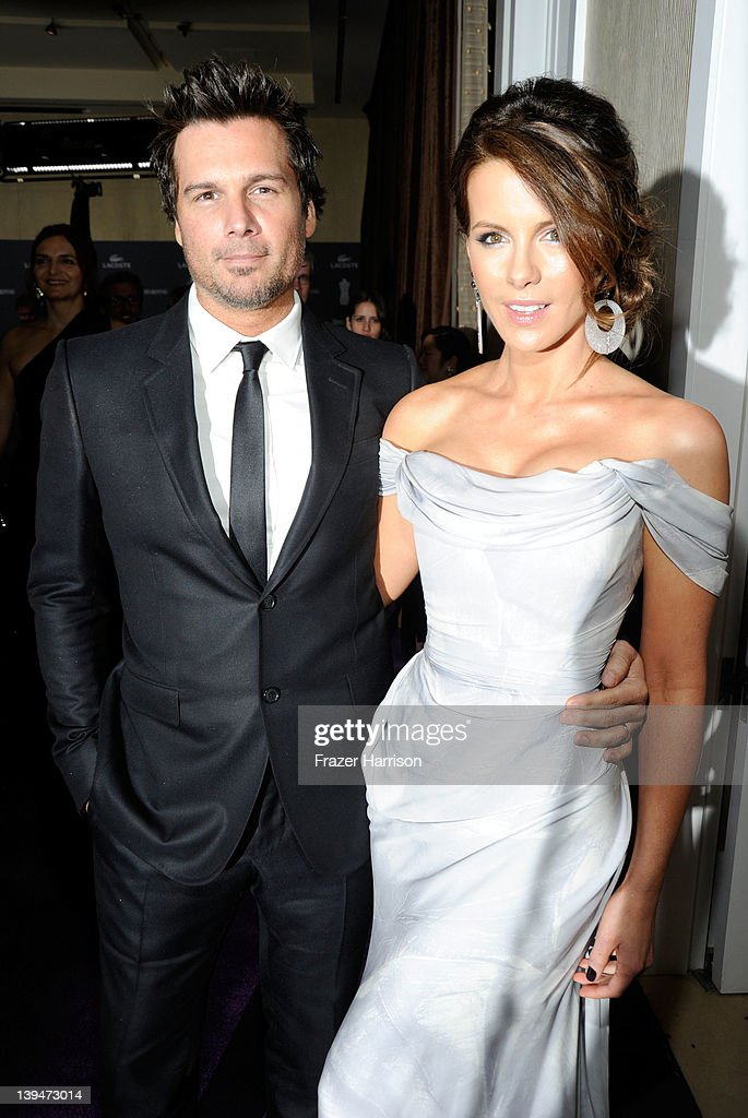 Actress <a gi-track='captionPersonalityLinkClicked' href=/galleries/search?phrase=Kate+Beckinsale&family=editorial&specificpeople=202911 ng-click='$event.stopPropagation()'>Kate Beckinsale</a> and husband <a gi-track='captionPersonalityLinkClicked' href=/galleries/search?phrase=Len+Wiseman&family=editorial&specificpeople=224848 ng-click='$event.stopPropagation()'>Len Wiseman</a> arrive at the 14th Annual Costume Designers Guild Awards With Presenting Sponsor Lacoste held at The Beverly Hilton hotel on February 21, 2012 in Beverly Hills, California.