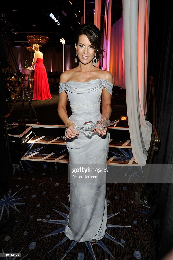 Actress Kate Beckinsale poses with the Lacoste Spolight Award during the 14th Annual Costume Designers Guild Awards With Presenting Sponsor Lacoste held at The Beverly Hilton hotel on February 21, 2012 in Beverly Hills, California.