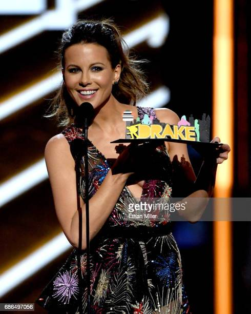 Actress Kate Beckinsale presents an award onstage during the 2017 Billboard Music Awards at TMobile Arena on May 21 2017 in Las Vegas Nevada