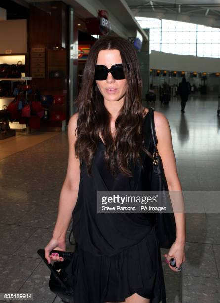 Actress Kate Beckinsale walks through Terminal 5 at Heathrow Airport Middlesex as she and her daughter Lily catch a flight