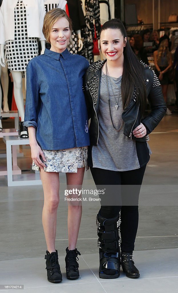 Actress Kate Bosworth (L) and recording artist Demi Lovato attend the Topshop Topman LA Grand Opening at The Grove on February 14, 2013 in Los Angeles, California.