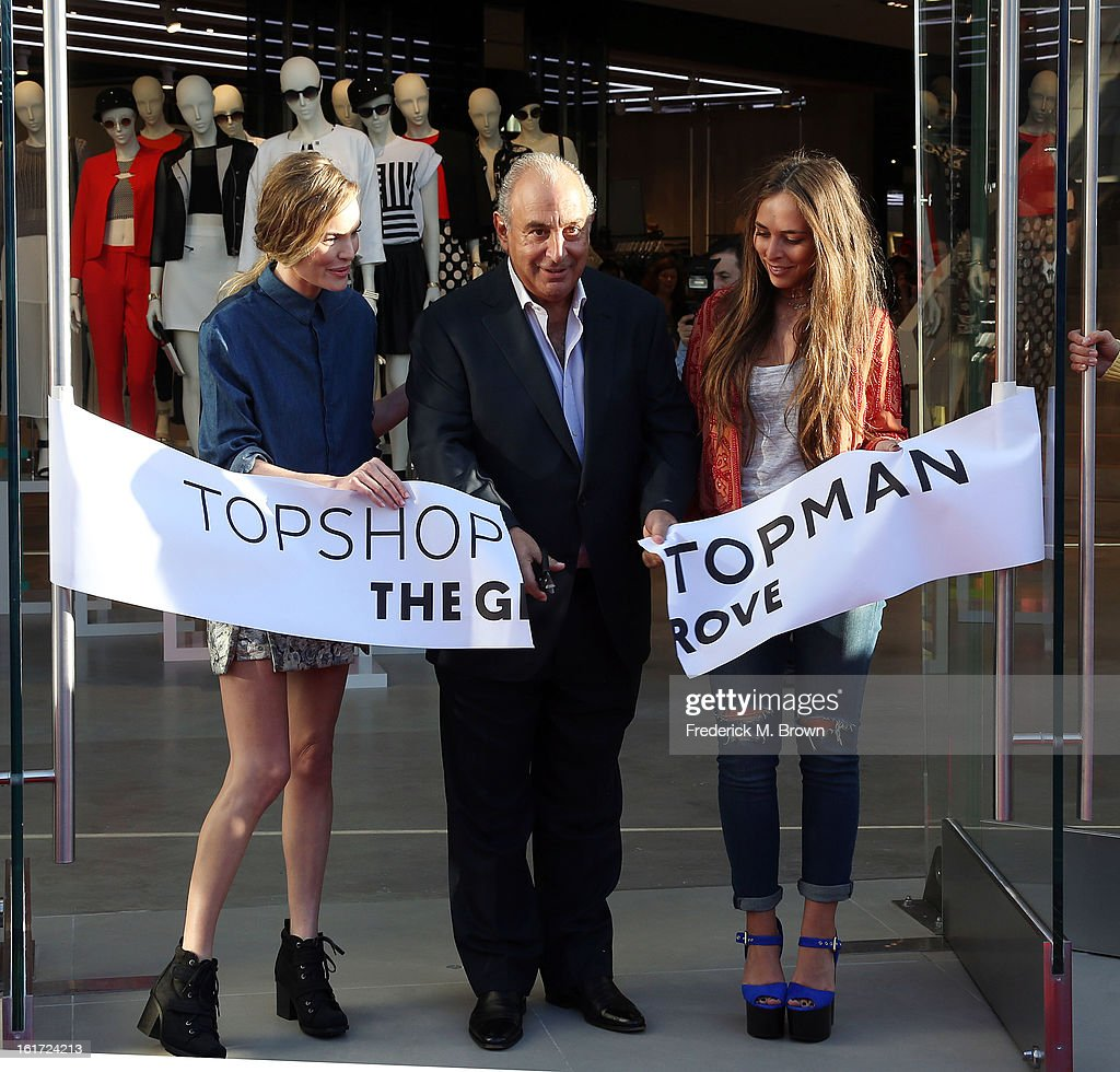 Actress Kate Bosworth, proprietor Sir Phillip Green, and Chloe Green attend the Topshop Topman LA Grand Opening at The Grove on February 14, 2013 in Los Angeles, California.