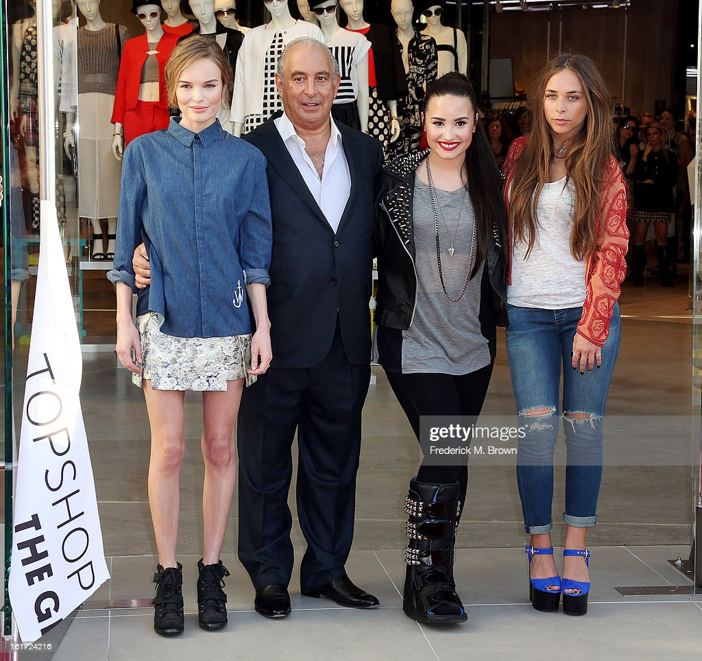 Actress Kate Bosworth, proprietor Sir Phillip Green, recording artist Demi Lovato, and Chloe Green attend the Topshop Topman LA Grand Opening at The Grove on February 14, 2013 in Los Angeles, California.