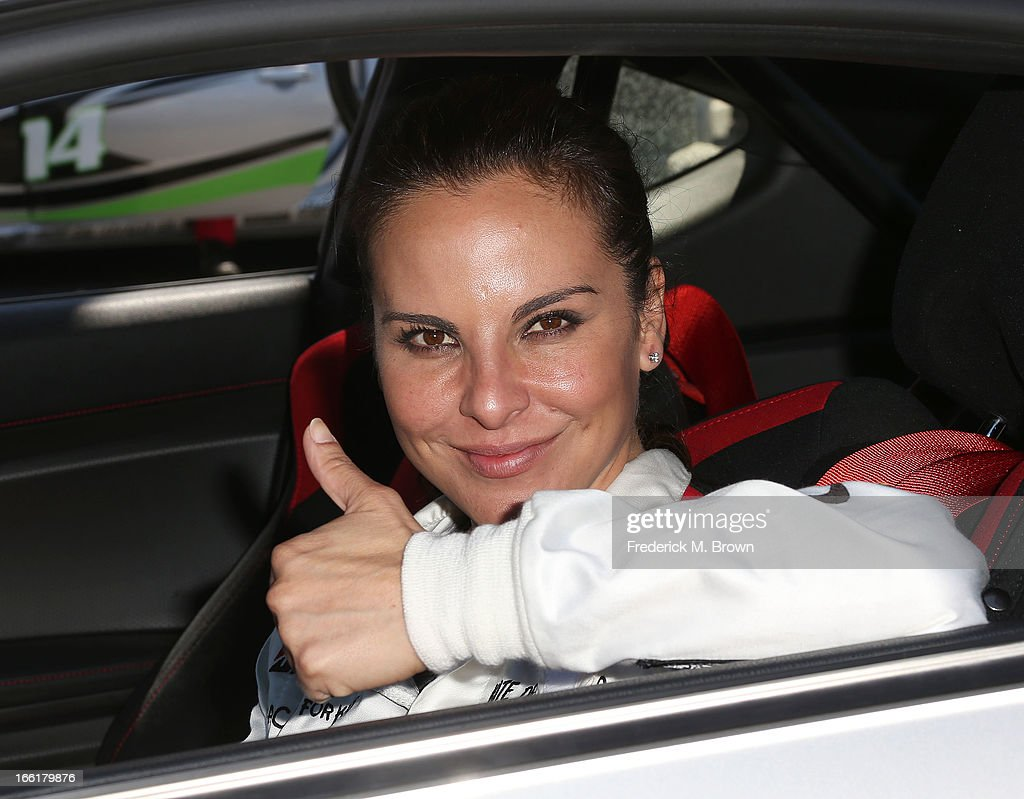 Actress <a gi-track='captionPersonalityLinkClicked' href=/galleries/search?phrase=Kate+del+Castillo&family=editorial&specificpeople=751402 ng-click='$event.stopPropagation()'>Kate del Castillo</a> attends the 37th Annual Toyota Pro/Celebrity Race-Practice Day on April 9, 2013 in Long Beach, California.