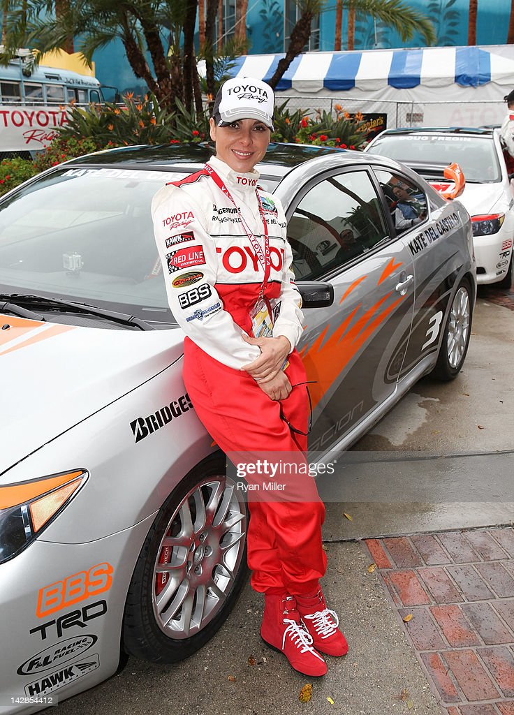 Actress Kate Del Castillo poses with her car during the 36th Annual Toyota Pro/Celebrity Race - Press Practice Day of the Toyota Grand Prix of Long Beach on April 13, 2012 in Long Beach, California.