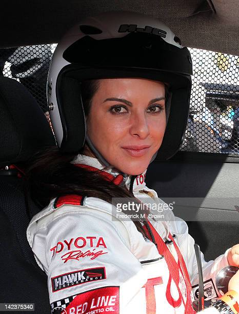 Actress Kate del Castillo sits in her race car during the 36th Annual Toyota Pro/Celebrity Race Press Practice Day of the Toyota Grand Prix of Long...