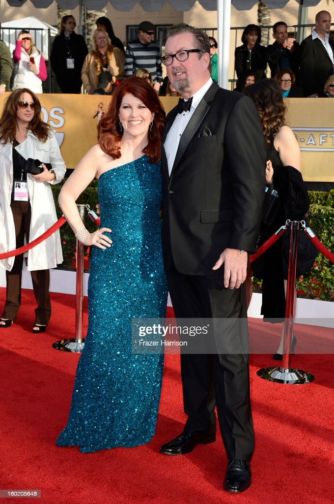 Actress Kate Flannery (L) and husband Chris Haston arrive at the 19th Annual Screen Actors Guild Awards held at The Shrine Auditorium on January 27, 2013 in Los Angeles, California.