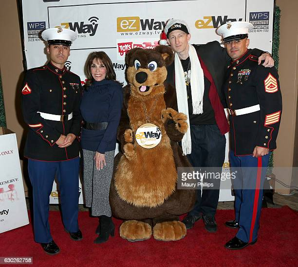 Actress Kate Linder Eric Zuley pose with US Marines during eZWayCares Community Santa Toy Drive on December 18 2016 in Los Angeles California