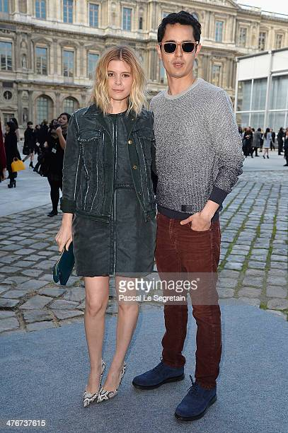 Actress Kate Mara and boyfriend Max Minghella arrive at the Louis Vuitton show as part of the Paris Fashion Week Womenswear Fall/Winter 20142015 on...